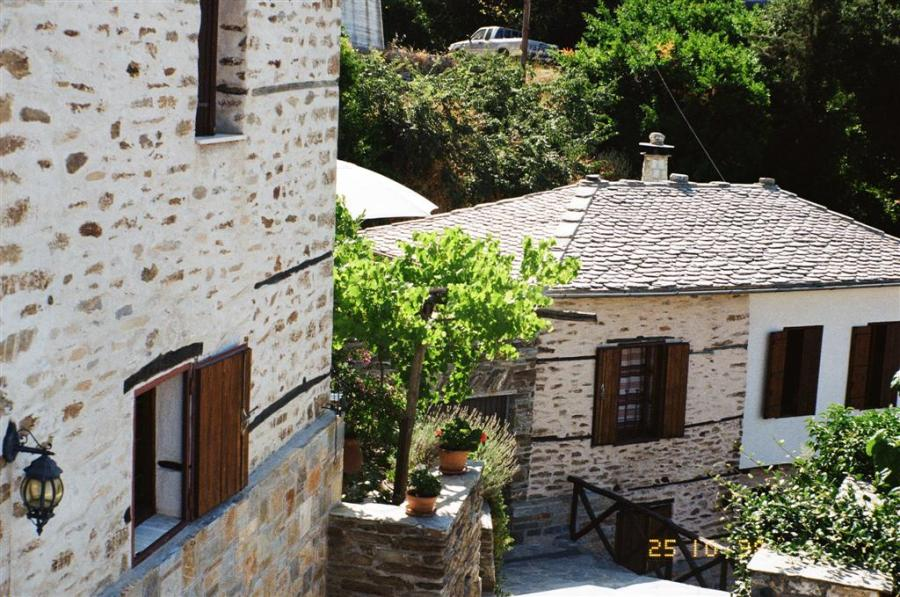 A tastefully restored mansion plus a traditional stone house